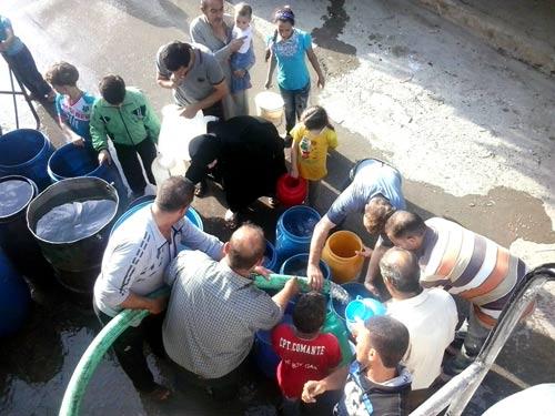 Distribution  d'eau  ©Edouard Elias/PU-AMI